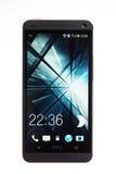 Smartphone HTC Jeden, odizolowywający na bielu Zdjęcie Stock