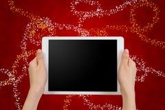 Smartphone humano del control de la mano, tableta, teléfono celular con pedregal en blanco Fotografía de archivo