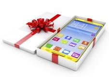 Smartphone i en gåva boxas Isolerat framför på en vit bakgrund Royaltyfri Fotografi