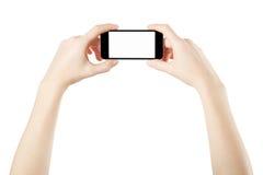 Smartphone i kvinnlighänder som tar fotoet royaltyfri bild