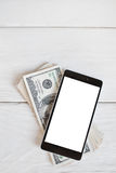 Smartphone i sto dolarowi rachunków, mockup Zdjęcia Royalty Free