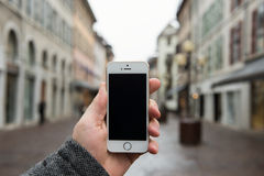 Smartphone with isolated screen in male hands. Royalty Free Stock Photos