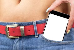 Smartphone with isolated white screen with empty space for text in a jeans pocket of a young beautiful girl. Royalty Free Stock Photography