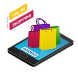 Smartphone isométrico com sacos de compras coloridos Fotografia de Stock Royalty Free