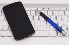 Smartphone and keyboard Stock Image