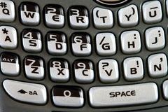 Smartphone keyboard macro. Macro of a smartphone cellular phone qwerty keyboard Stock Image