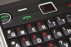 Smartphone keyboard macro. Macro of a smartphone cellular phone qwerty keyboard stock image