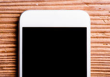 Smartphone laid on an old office desk, copy space Royalty Free Stock Photography