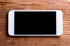 Smartphone laid on an old office desk, copy space Stock Images