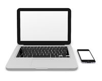 Smartphone and laptop. Laptop and smartphone on white background next to each other with blank screens Royalty Free Stock Photography