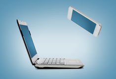 Smartphone and laptop conncecting Stock Photography