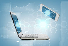 Smartphone and laptop conncecting Stock Images