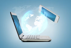 Smartphone and laptop conncecting Royalty Free Stock Image