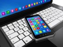 Smartphone on Laptop Royalty Free Stock Image