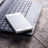 Smartphone and laptop Royalty Free Stock Photography
