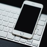 Smartphone laying on black background. Mouse and keyboard isolated.  royalty free stock photography