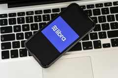 18 June 2019, Ljubljana Slovenia - smartphone on a computer keyboard with Libra coin logo, Facebook`s new global royalty free stock photos