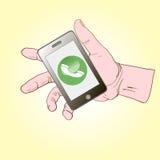 Smartphone liegt auf der Palme und nennt Stockfotos
