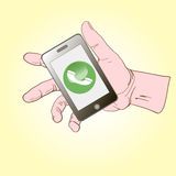 Smartphone ligger på gömma i handflatan och appellerna Arkivfoton