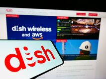 Smartphone with logo of US television company DISH Network Corporation on screen in front of business website.