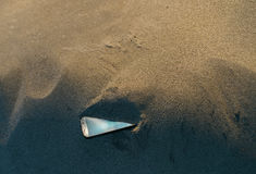 Smartphone lost in the sand stock photos
