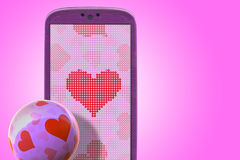 Smartphone love. Pink smartphone and hear shapes. Idea for Valentines Day messages, love, lovers, love apps, Internet, blogs and others stock photo