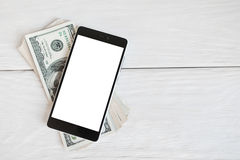 Smartphone lying on american dollars, free space Stock Images