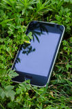 Smartphone lying on the grass Royalty Free Stock Photography