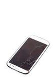 Smartphone móvil con la pantalla quebrada Imagenes de archivo
