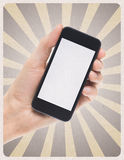 Smartphone móvil a disposición en fondo retro Fotografía de archivo libre de regalías