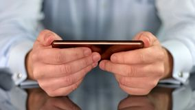 Smartphone in male hands closeup, business application, social networks, gadget royalty free stock photo