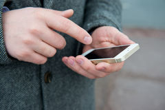 Smartphone in male hands. Picture can be used in advertisement and websites Stock Image