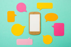 Smartphone with many speech bubbles - mobile marketing Stock Photos