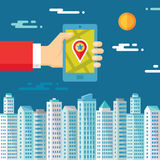 Smartphone with map & location in human hand on the background of the city for presentation and different design works. Stock Photos