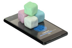 Smartphone and marshmallows Stock Photos