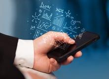 Smartphone med affärsintrig Arkivfoto