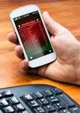Smartphone med avvikelser stiger ombord direktanslutet Fotografering för Bildbyråer