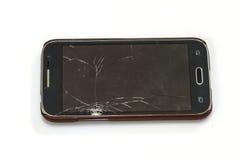Smartphone med den brutna skärmen Arkivbild