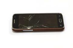 Smartphone med den brutna skärmen Fotografering för Bildbyråer