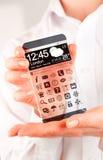 Smartphone med den genomskinliga skärmen i mänskliga händer Arkivfoton