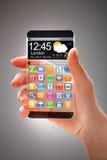 Smartphone med den genomskinliga skärmen i mänskliga händer Royaltyfria Foton