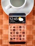 Smartphone med en genomskinlig skärm Arkivfoto