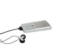 Smartphone med hörlurar Royaltyfria Bilder