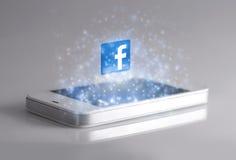Smartphone med symbolen för 3d Facebook Royaltyfri Bild