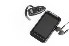 Smartphone met toebehoren Stock Afbeelding