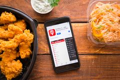 Smartphone with mobile application. Stavropol, Russian Federation. June 10, 2019. Smartphone with mobile application BonMenu.kz-table booking and food delivery royalty free stock photos