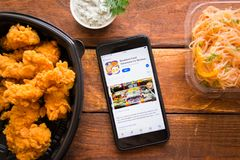 Smartphone with mobile application. Stavropol, Russian Federation. June 10, 2019. Smartphone with mobile application Breakfast Food Adventure For stock photo