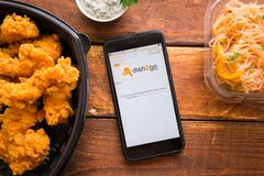 Smartphone with mobile application. Stavropol, Russian Federation. June 10, 2019. Smartphone with mobile application dish2go-Food Delivery stock image