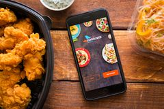 Smartphone with mobile application. Stavropol, Russian Federation. June 10, 2019. Smartphone with mobile application FoodJets stock image