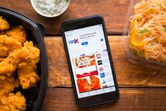 Smartphone with mobile application. Stavropol, Russian Federation. June 10, 2019. Smartphone with mobile application FoodX Restaurant Delivery Service royalty free stock photos